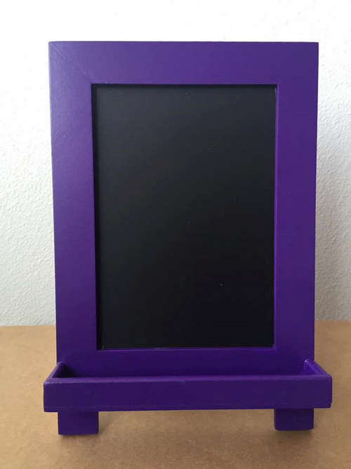 office chalkboard with purple frame