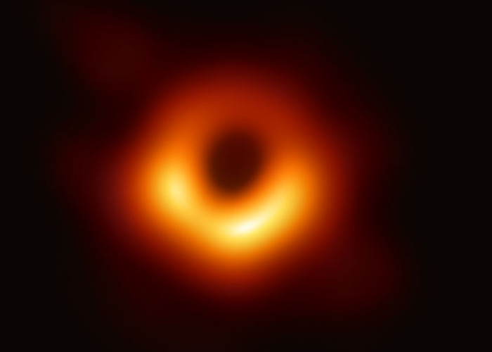 the first image of a black hole was released in 2019 and the black hole isn't pitch dark. In fact, it is surrounded by light trapped by the black hole.